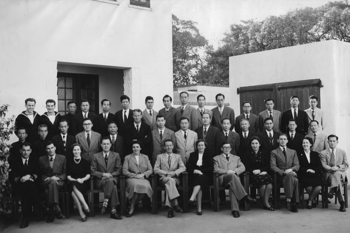 The Briton with Hong Kong Observatory staff on the day he retired as director, in 1955.