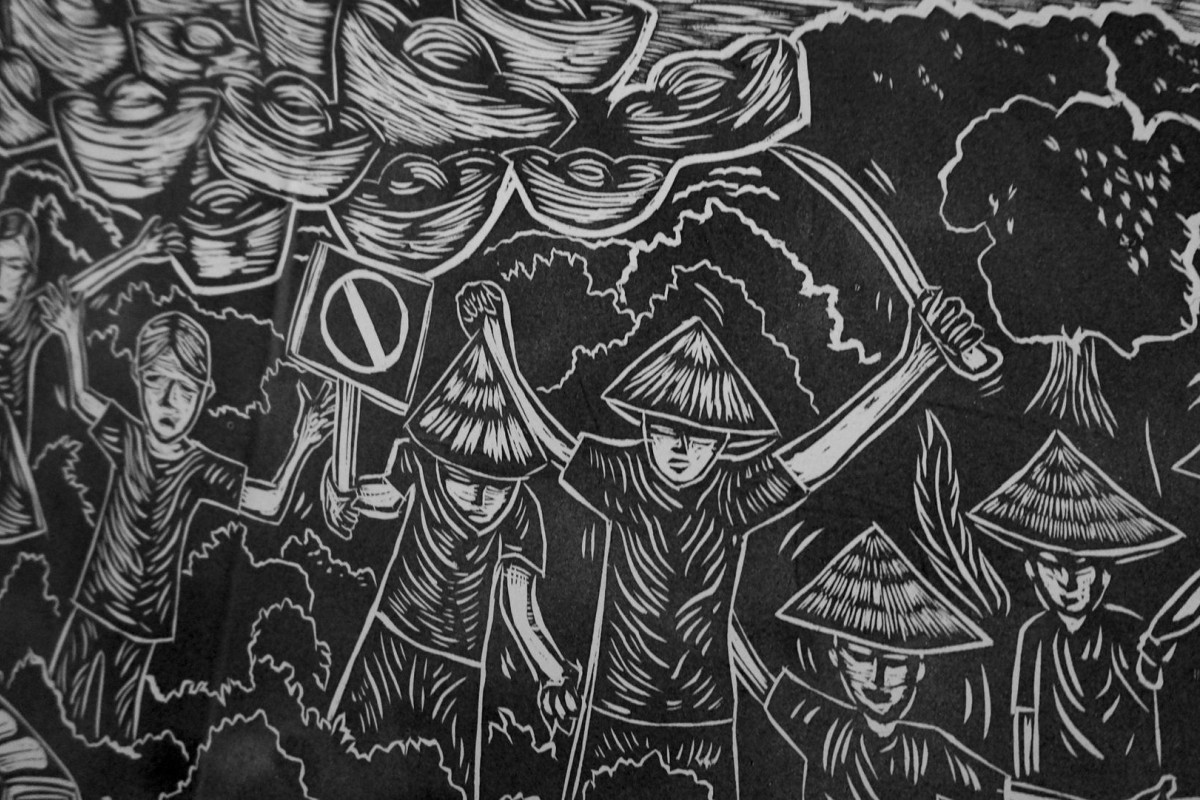 A woodcut print work by Pangrok Sulap depicts a protest against the Mamut Copper Mine work is political in nature. Photos: Nathan Thompson