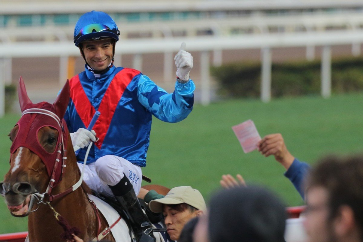 Joao Moreira celebrates with the crowd after making it a treble on Rapper Dragon. Photo: Kenneth Chan