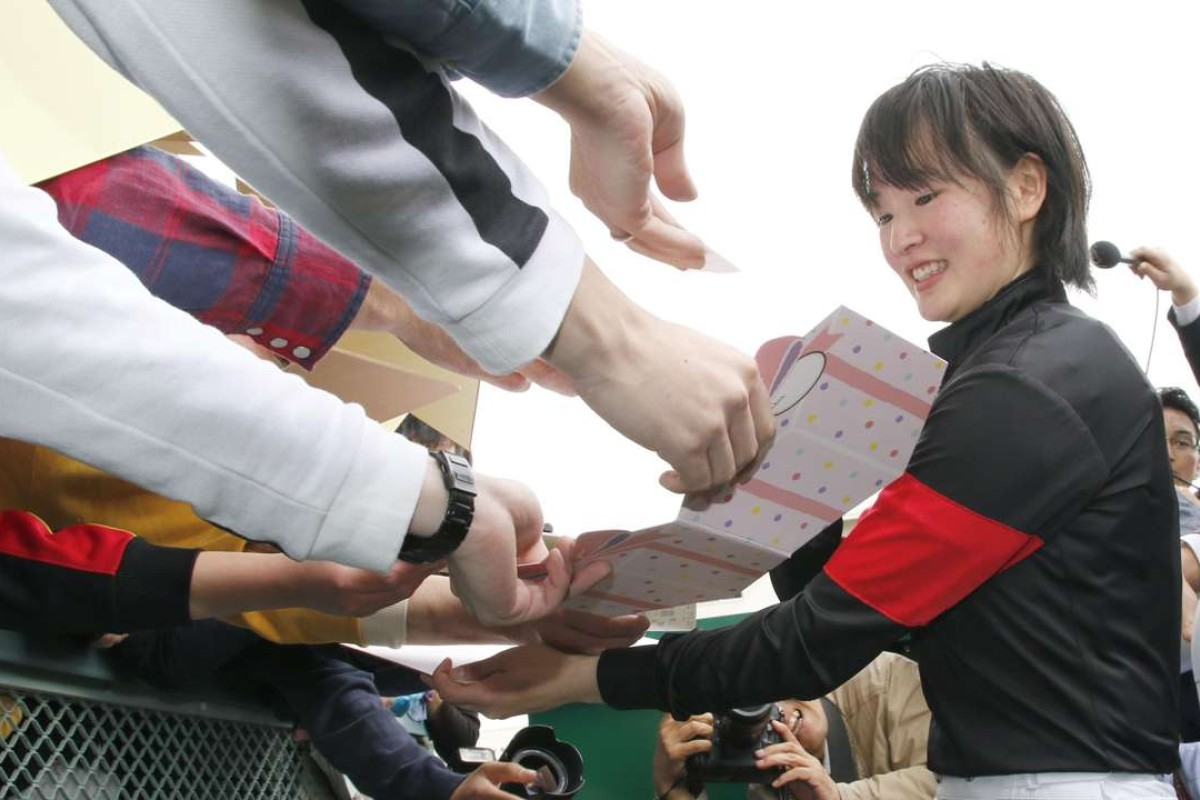Nanako Fujita was mobbed by fans and press after her first JRA win on Sunny Days at Fukushima. Photo: Kyodo