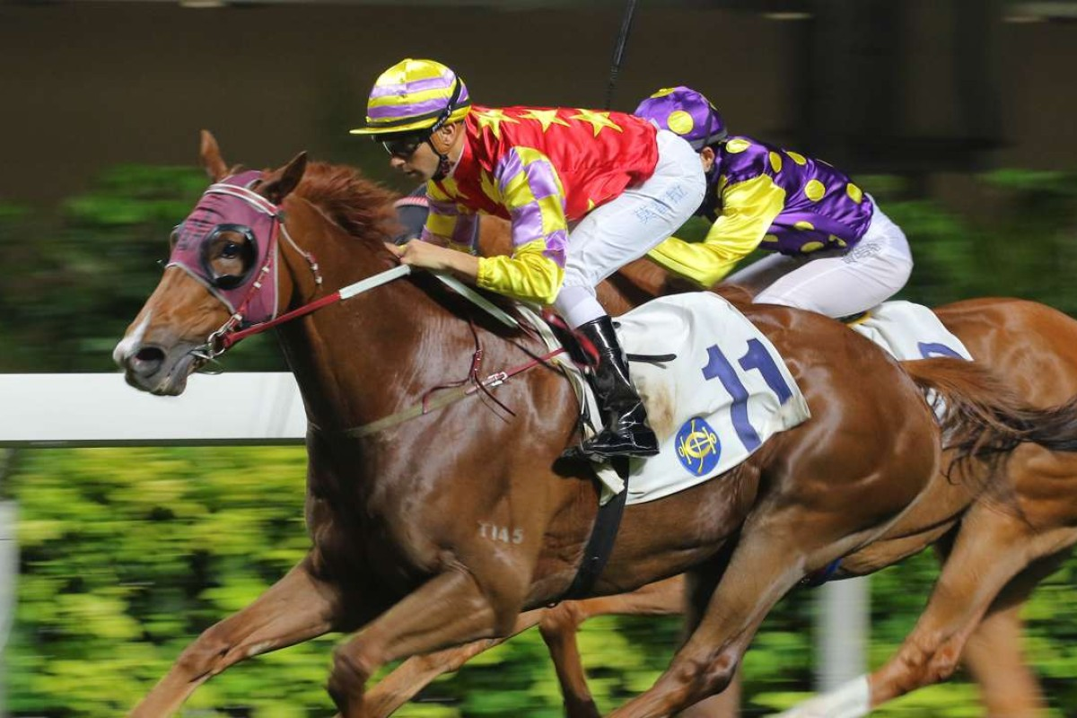 Lotus Strikes Back (Joao Moreira) breaks through for trainer John Moore, winning the France Galop Cup at Happy Valley on Wednesday night. Photos: Kenneth Chan