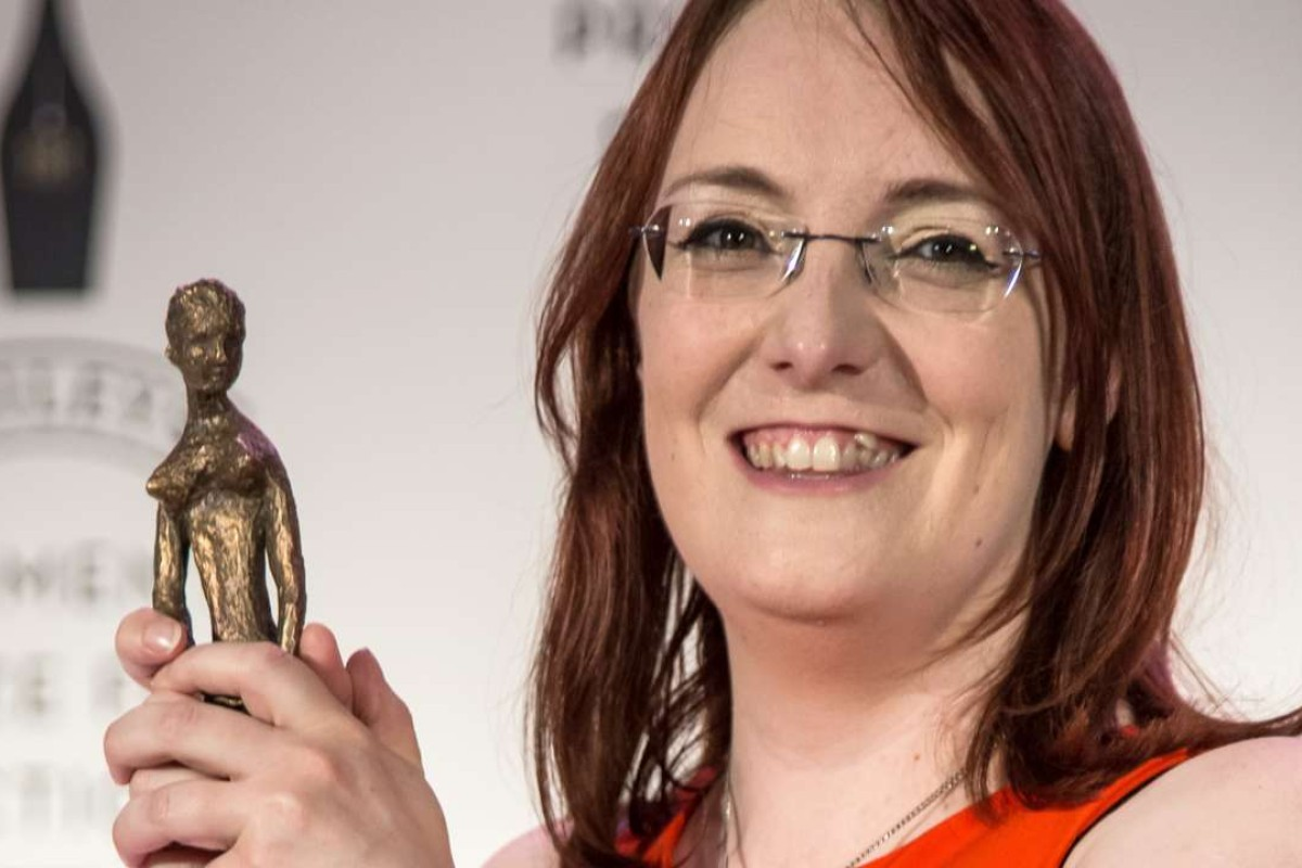 Novelist Lisa McInerney is all smiles after receiving the Baileys Women's Prize for Fiction for The Glorious Heresies, in London, last month. Photo: AP