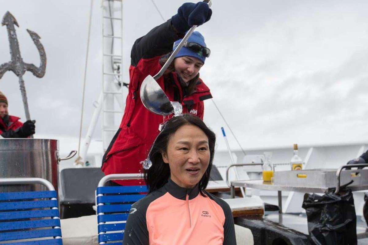 Beijinger Cindy Li undergoes the ice bucket challenge aboard a cruise ship in Antarctica. Photos: Daniel Allen