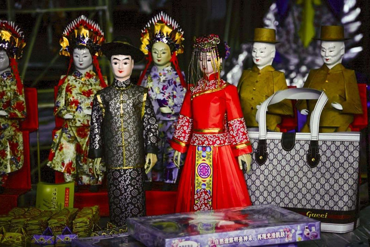 """Dolls represent the happy couple in a Chinese-style """"ghost wedding""""."""