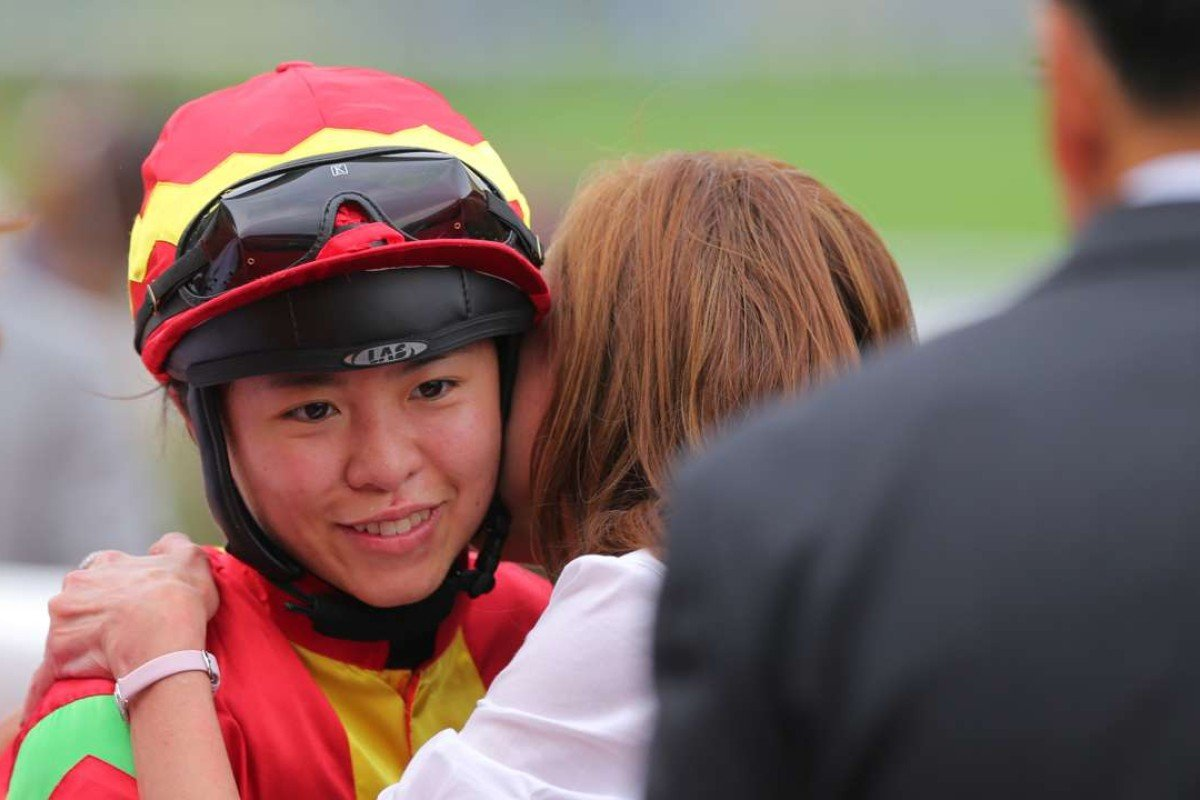 Kei Chiong receives a hug after her bizarre day culminates in a win on Multimax. Photo: Kenneth Chan