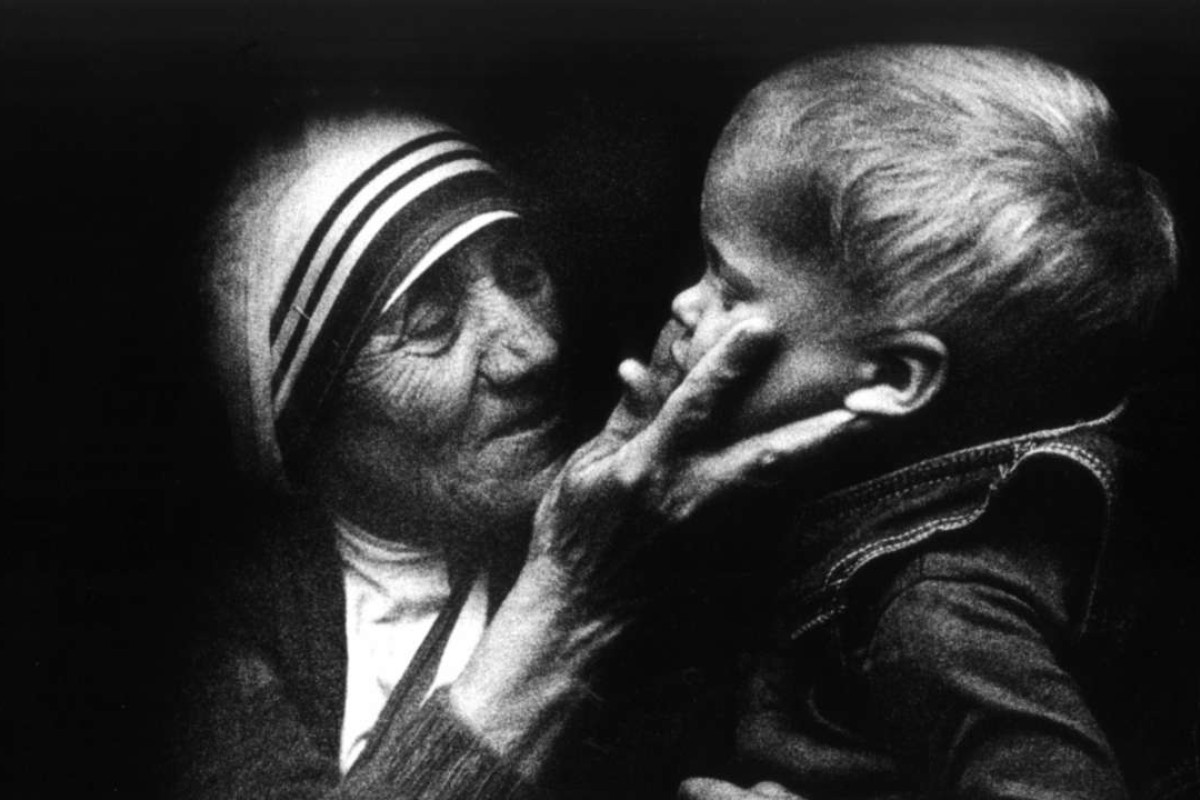 Mother Teresa from Calcutta, holds a Polish child during a visit to Poland. Photo: EPA