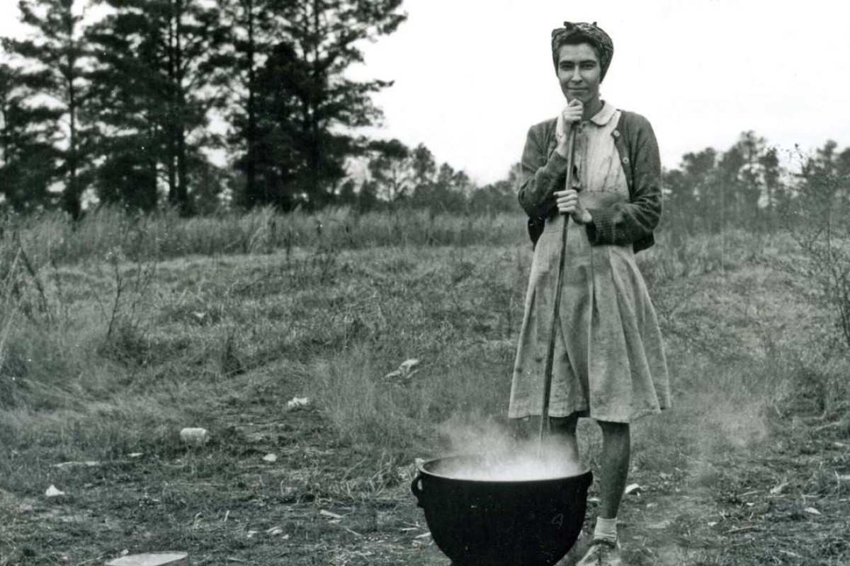 A woman in North Carolina, in the United States, prepares a meal at her dust-bowl-hit farm during the Great Depression. Picture: Alamy