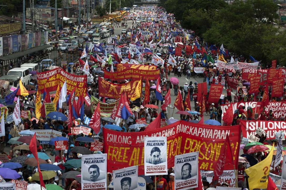 Demonstrators march to the House of Representatives to show their support for Philippine President Rodrigo Duterte ahead of his State of the Nation Address in July. Duterte used the address to announce a unilateral ceasefire with communist rebels who are waging one of Asia's longest insurgencies, and urged them to reciprocate. Photo: AFP