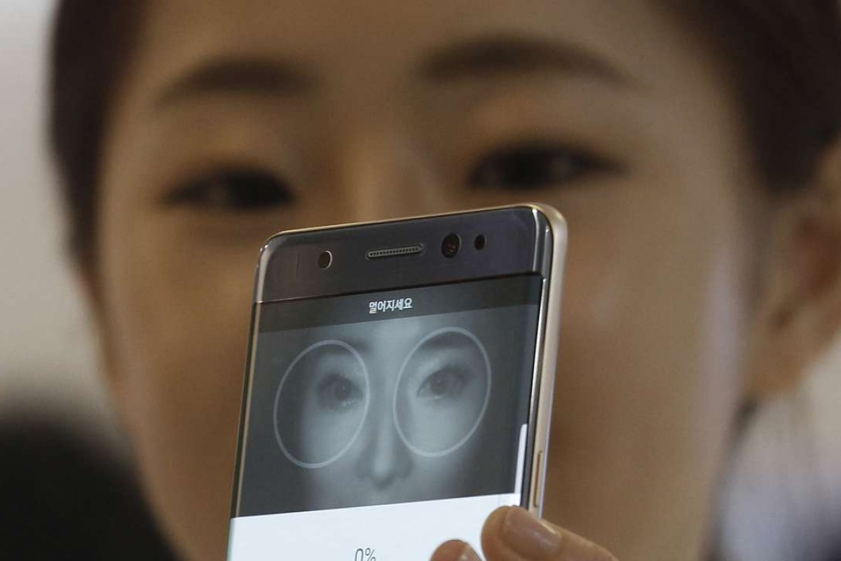 A model demonstrates the iris scanner features of the Galaxy Note 7 during its launch in August. Two months later, the phone has cast a deep shadow on Samsung's reputation. Photo: AP