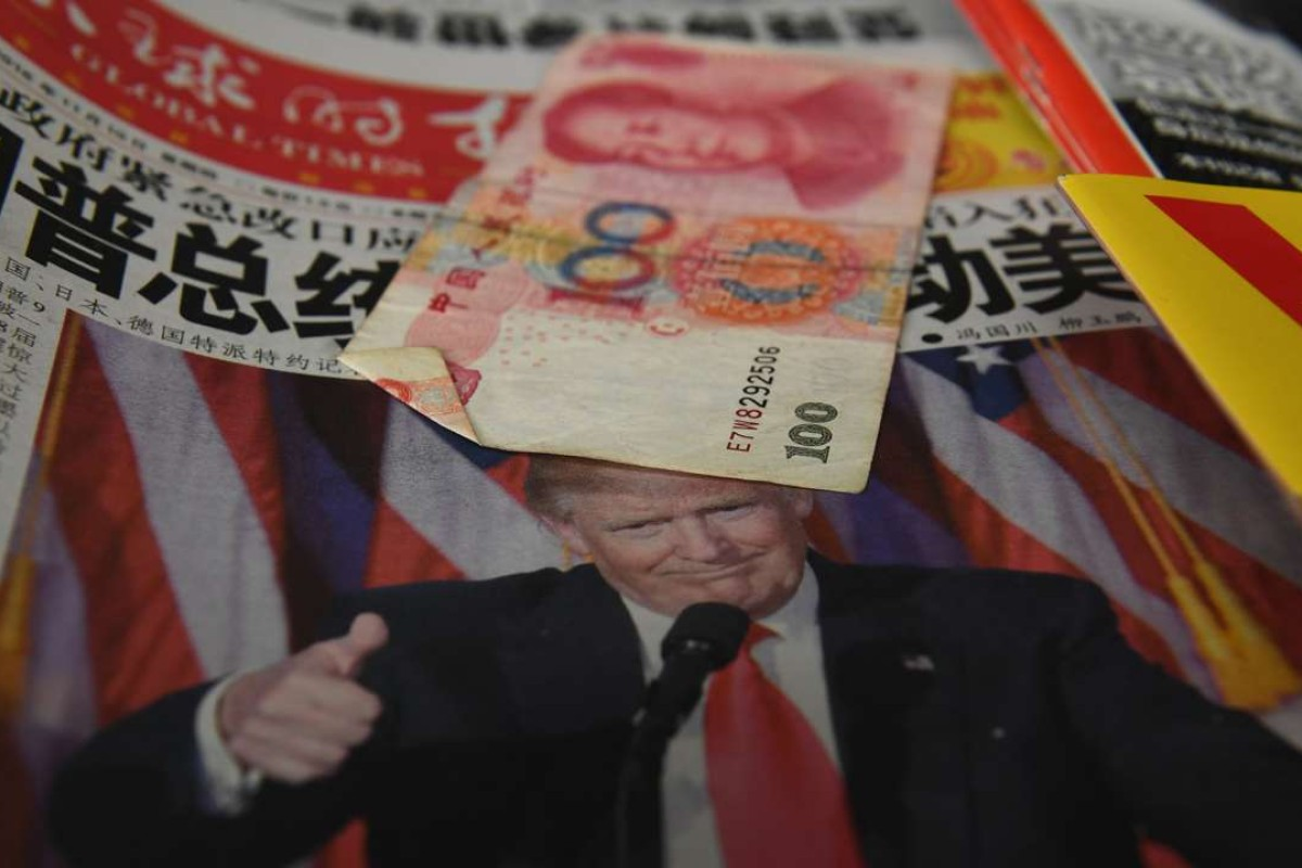 A Chinese newspaper headlined 'President Trump shakes America' on sale in Beijing. Photo: AFP