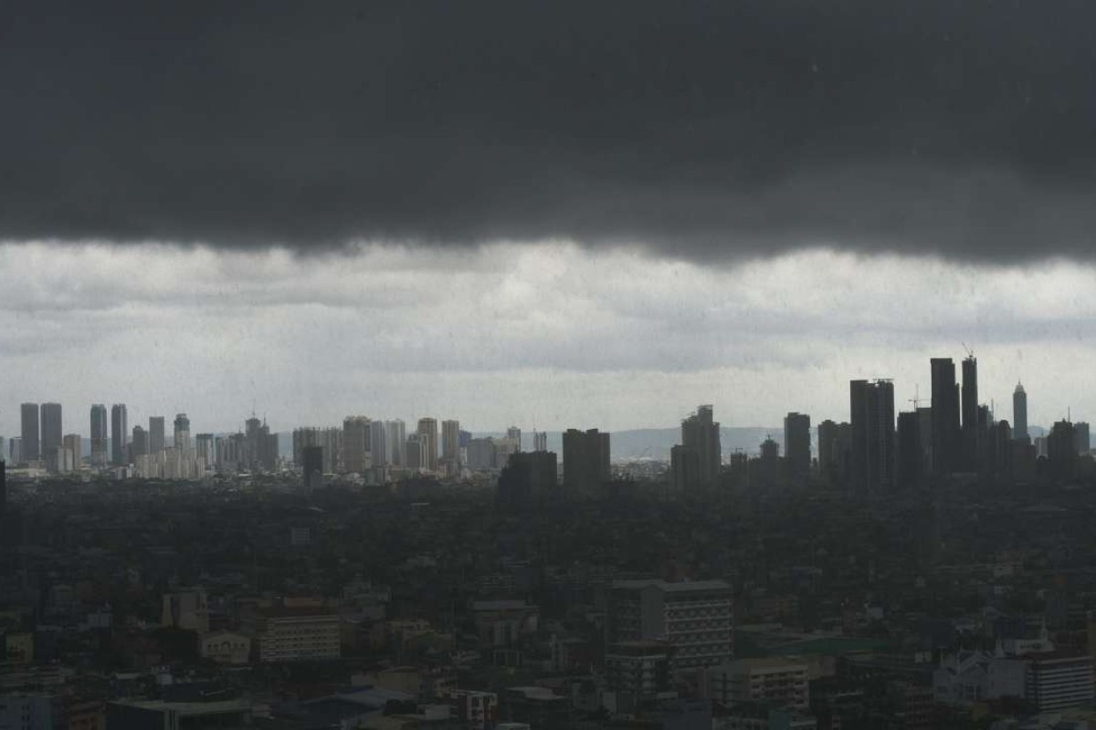 Dark storm clouds over the Manila skyline. Before Singapore, before Hong Kong, Manila was the undisputed centre of commerce in Asia Pacific. Photo: AFP