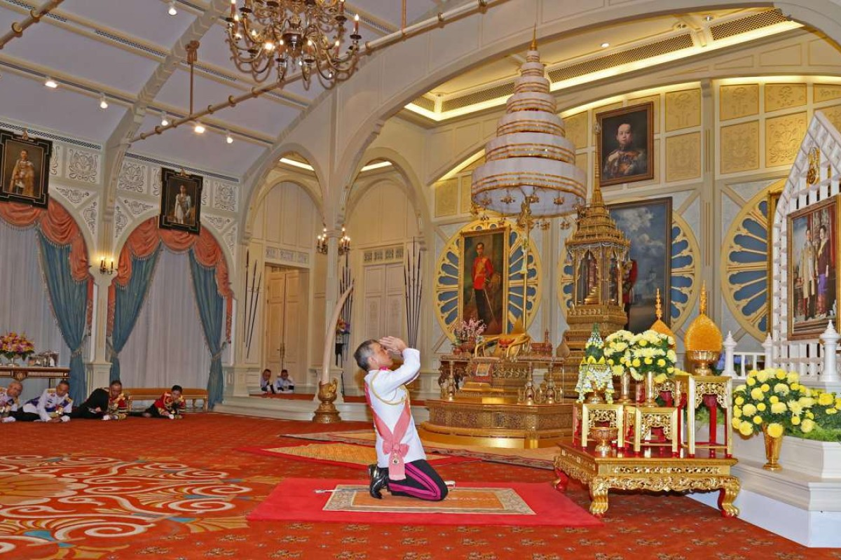 Thailand's new King Maha Vajiralongkorn Bodindradebayavarangkun pays respect to a picture of Thailand's late King Bhumibol Adulyadej and Queen Sirikit, as he accepts an invitation from parliament to succeed his father, at Bangkok's Dusit Palace in Bangkok. Photo: Reuters