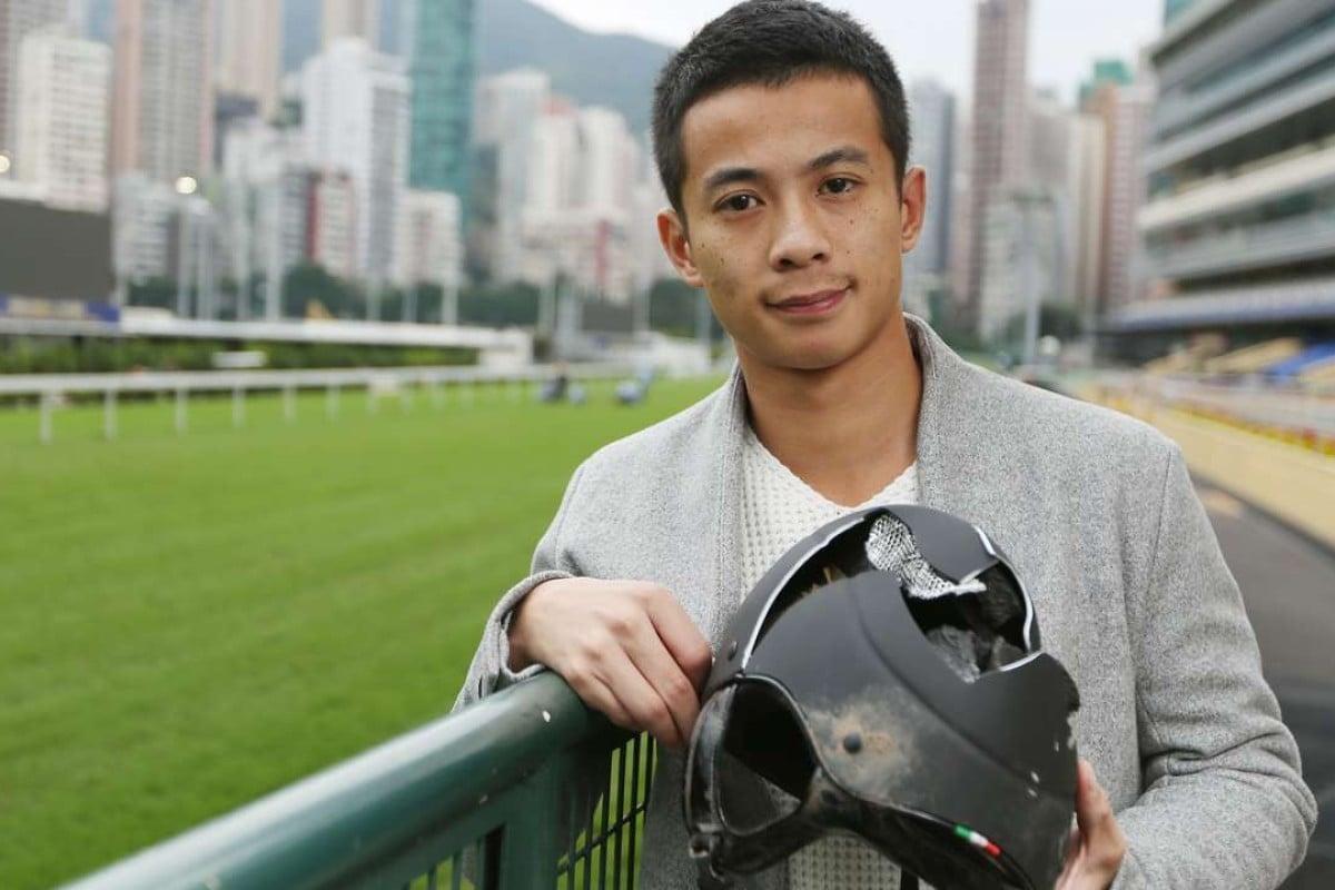 Jockey Derek Leung holds the helmet that saved his life. Photo: Xiaomei Chen