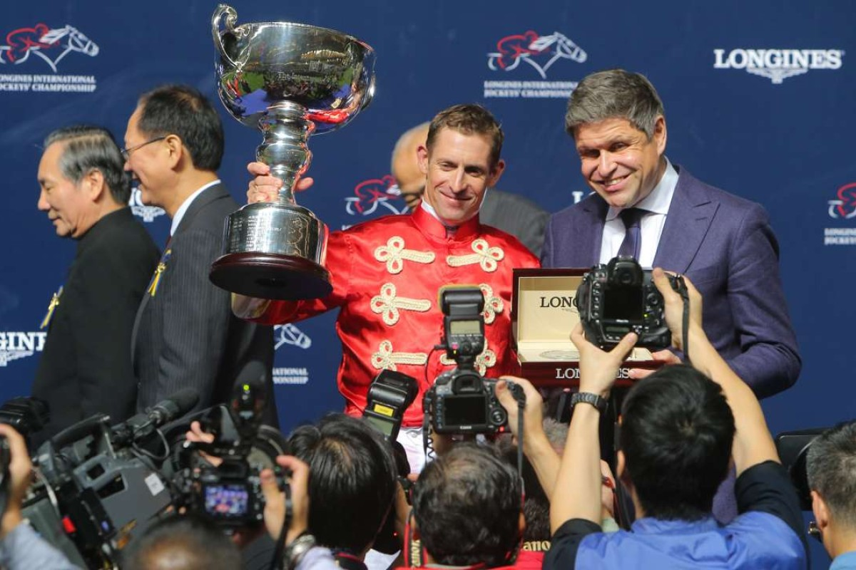 Jockey Hugh Bowman collects his International Jockeys' Championship trophy. Photos: Kenneth Chan