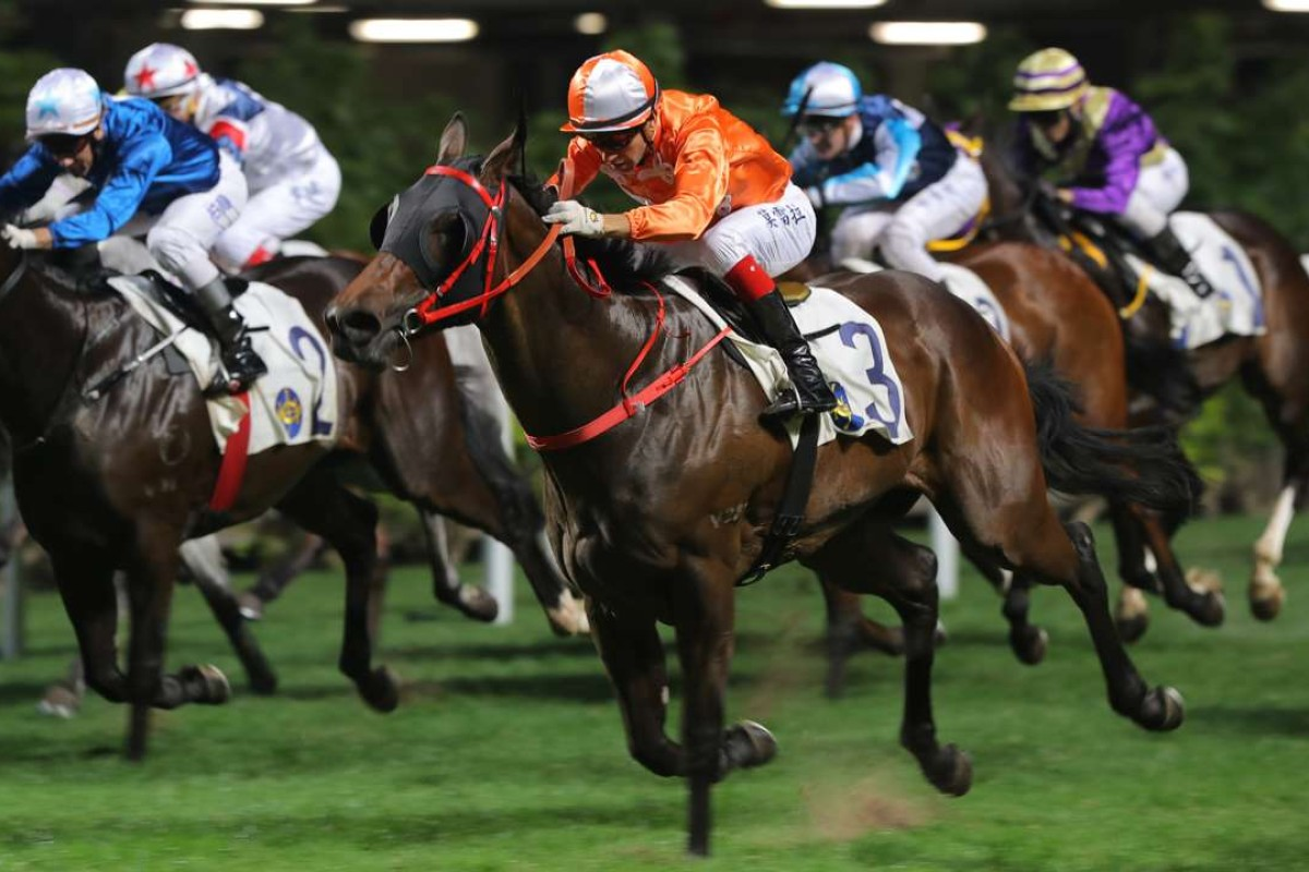 Love Shock storms down the centre of the track to win at Happy Valley on Wednesday night. Photos: Kenneth Chan