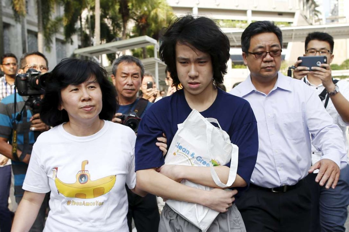 Teen blogger Amos Yee leaves court with his parents after his sentencing in Singapore last year. Photo: Reuters