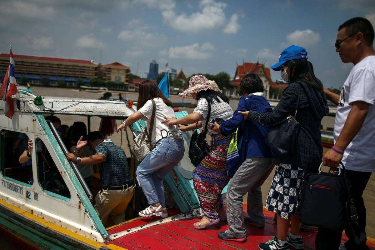 Chinese tourists board a sightseeing boat on the Chao Phraya River in Bangkok. Photo: Reuters