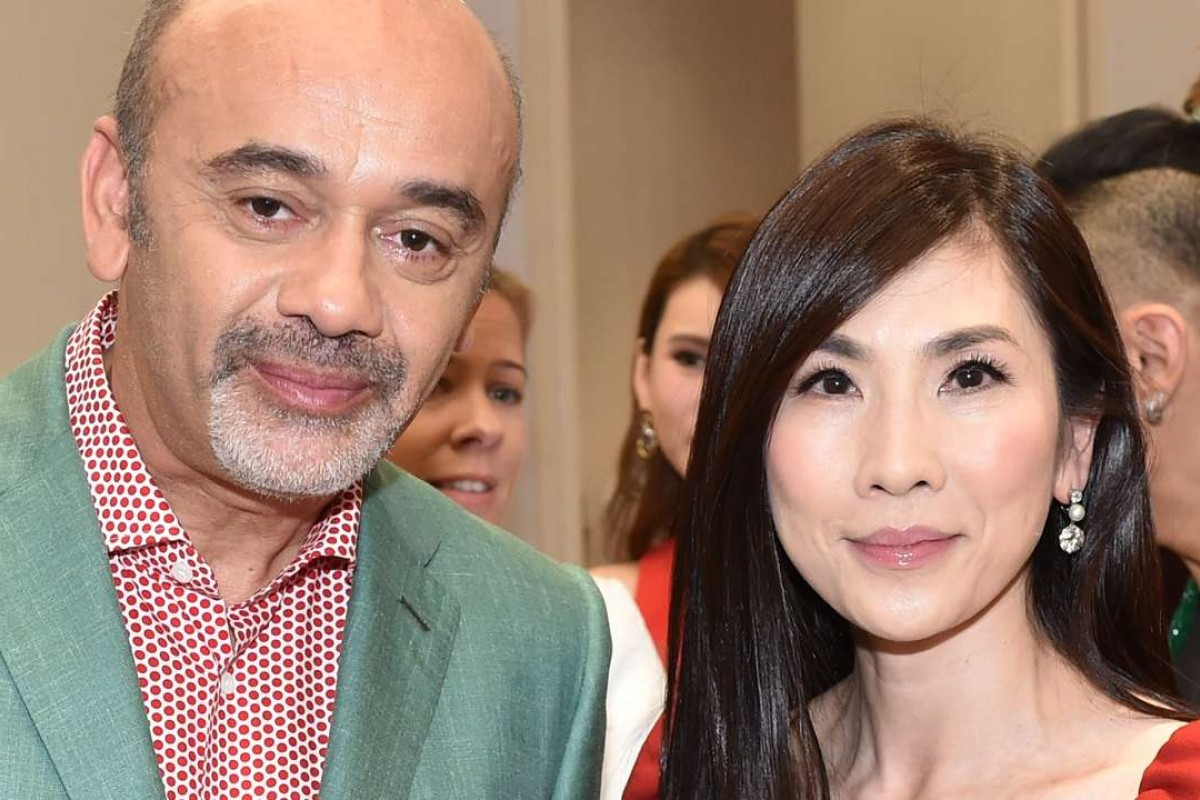 Christian Louboutin and Ming Ho at the Christian Louboutin Beauté Launch Cocktail at Lane Crawford
