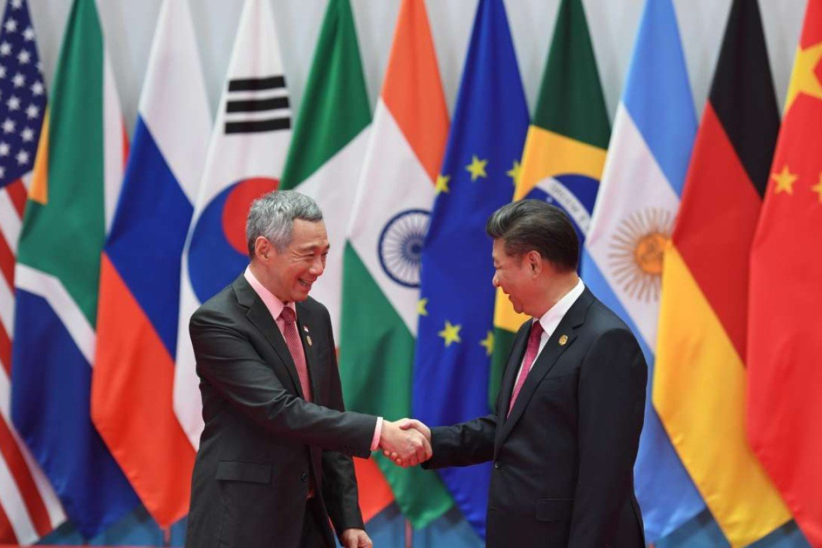 Singapore's Prime Minister Lee Hsien Loong and China's President Xi Jinping greet each other at the G20 leaders' arrival in Hangzhou in September. Photo: AFP