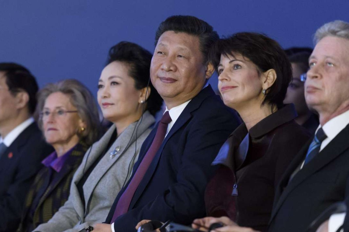 China's President Xi Jinping, and his wife Peng Liyuan, fourth from the right, attend the World Economic Forum, on January 17, in Davos, Switzerland. Photo: AFP