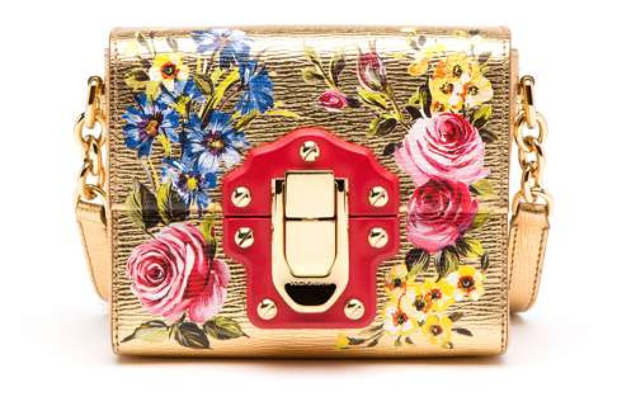 Dolce & Gabbana. The house continues its richly embellished looks by pairing elaborate floral print with vibrant colours for this golden bag, HK$14,900