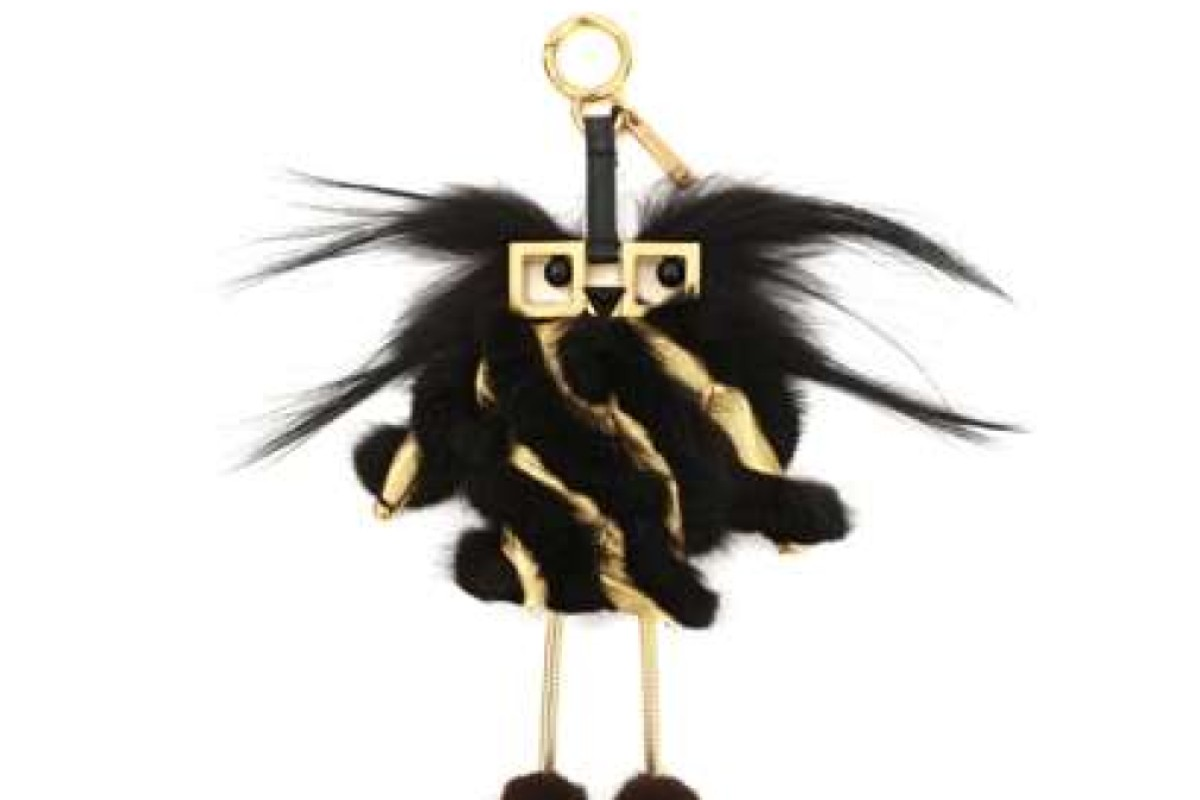 Fendi. Inspired by Fendi Faces, the Gold Edition Hypnodoll fur charm adds a cute touch to your bag. It can also be used to charge your smartphone, HK$12,300