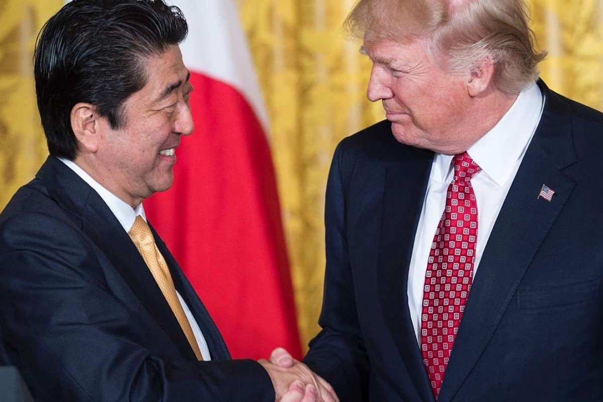 Japan's Prime Minister Shinzo Abe and US President Donald Trump shake hands after a press conference in the East Room of the White House. Photo: AFP