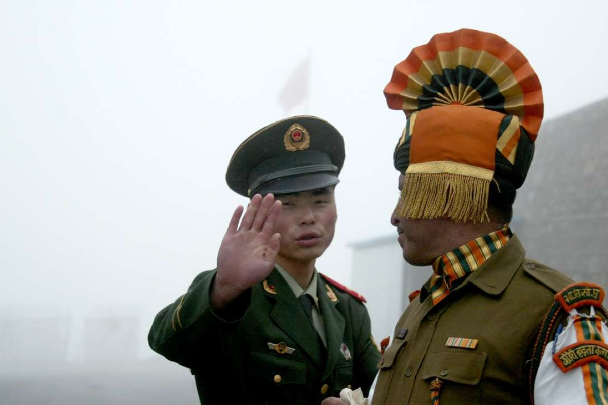 A Chinese soldier and an Indian counterpart on the Chinese side of the ancient Nathu La border crossing between India and China. Photo: AFP