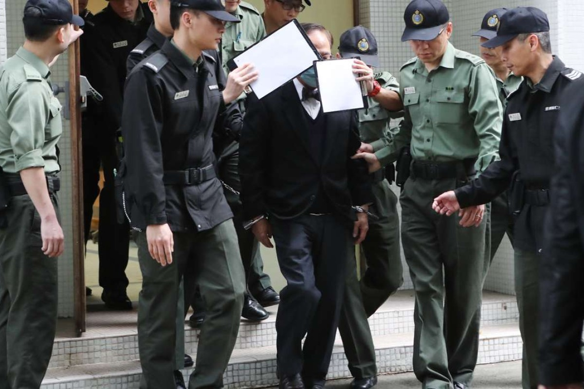 Former chief executive Donald Tsang is escorted to a prison van on February 22. Picture: Edward Wong