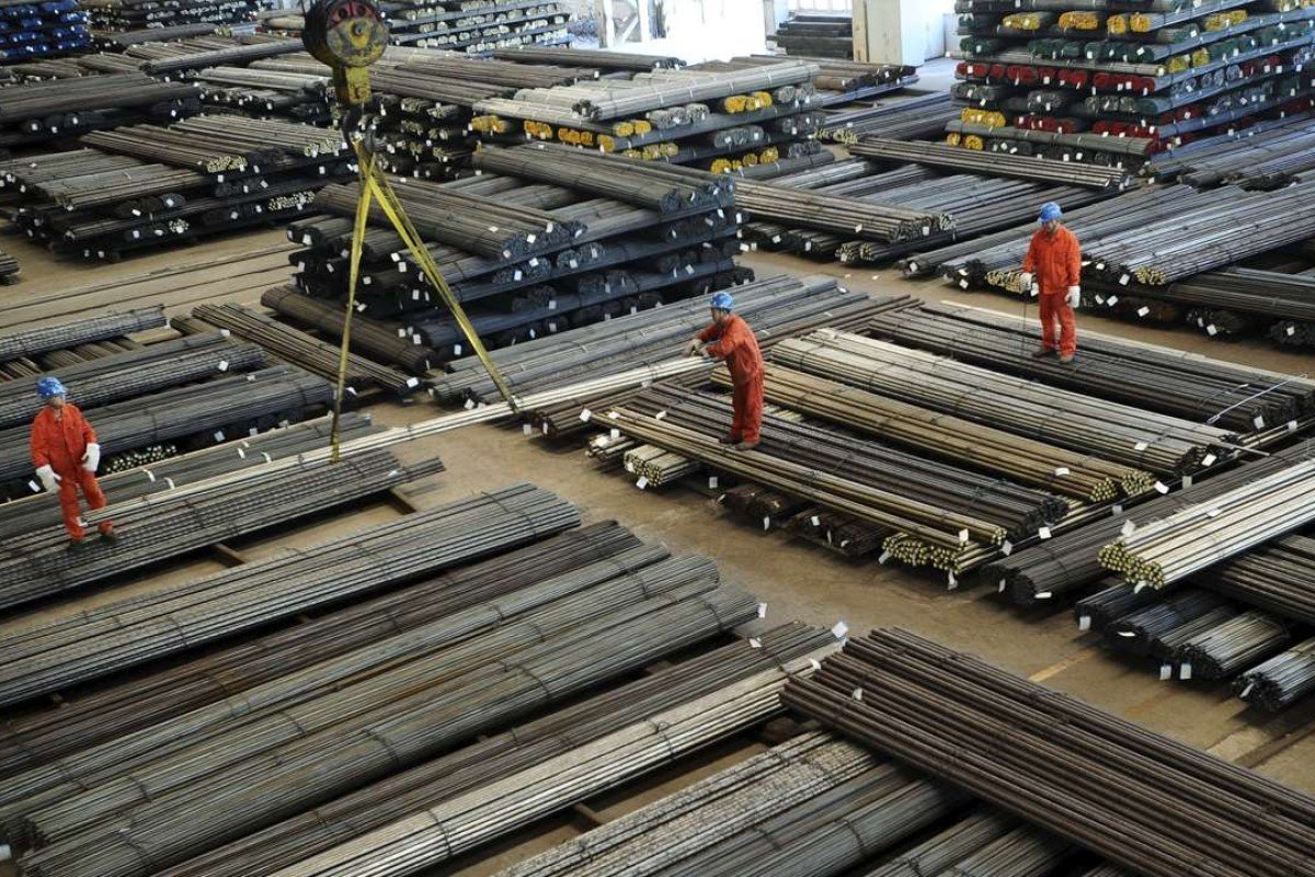 Workers direct a crane lifting newly made steel bars at a factory in Dalian, Liaoning province, China, Economic growth estimates have been in steady decline in China since 2010. Photo: Reuters