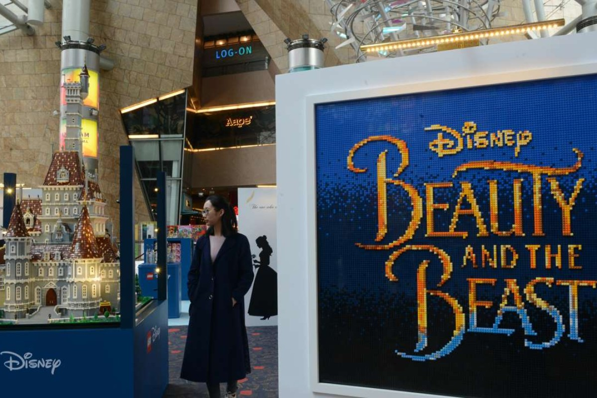 People visit a lego-inspired preview of Beauty and the Beast in Hong Kong. Photo: Xinhua