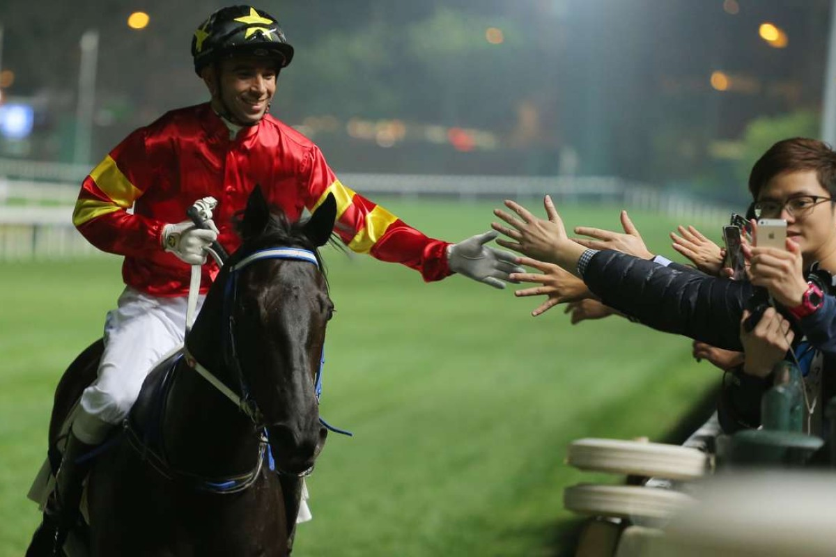 Joao Moreira poses for a selfie with a fan after winning aboard Marvel Hero at Happy Valley on Wednesday night. Photos: Kenneth Chan