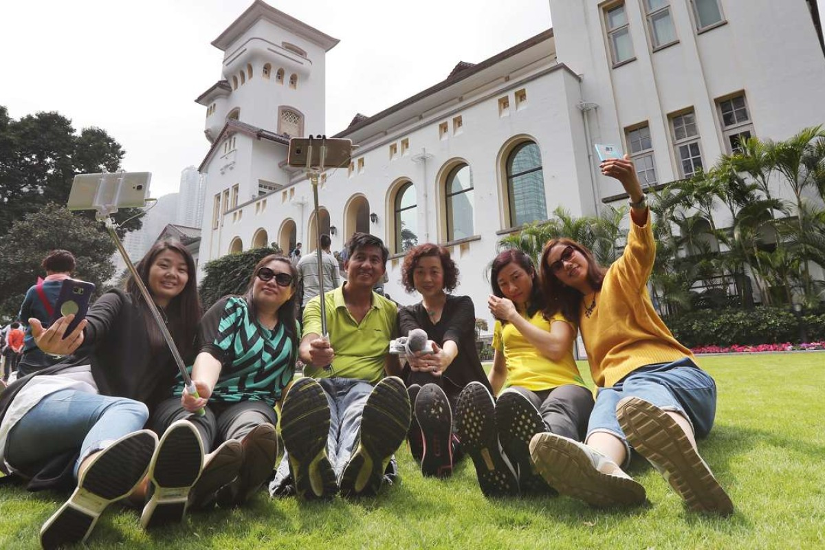Hundreds of Hong Kong citizens show up at Government House during the open day on March 5. One of the new chief executive's major issues will likely be Hong Kong's housing problems. Photo: Edward Wong