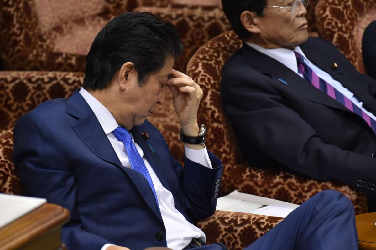 Japanese Prime Minister Shinzo Abe is under mounting pressure to explain his role in the scandal surrounding the Moritomo Gakuen school. Photo: AFP