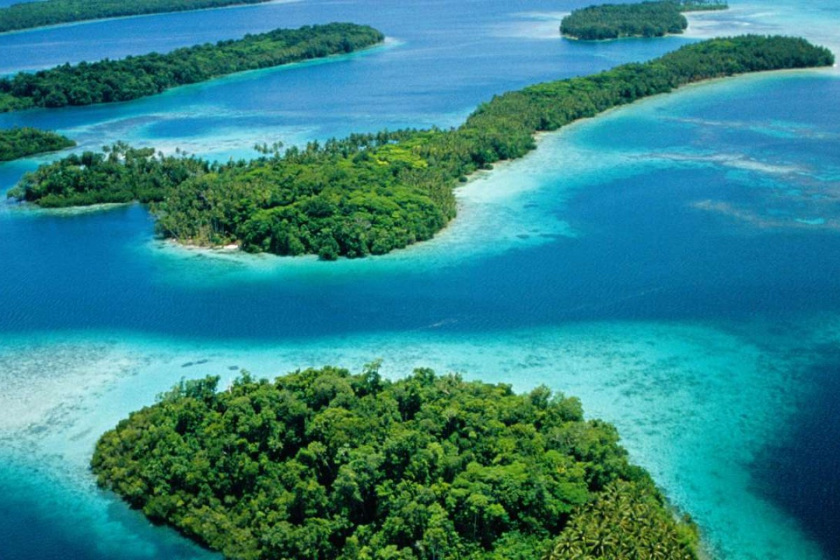 Islands fringed with coral reefs in New Georgia, in the Western Province of the Solomon Islands. Pictures: Julian Ryall; AFP; Alamy