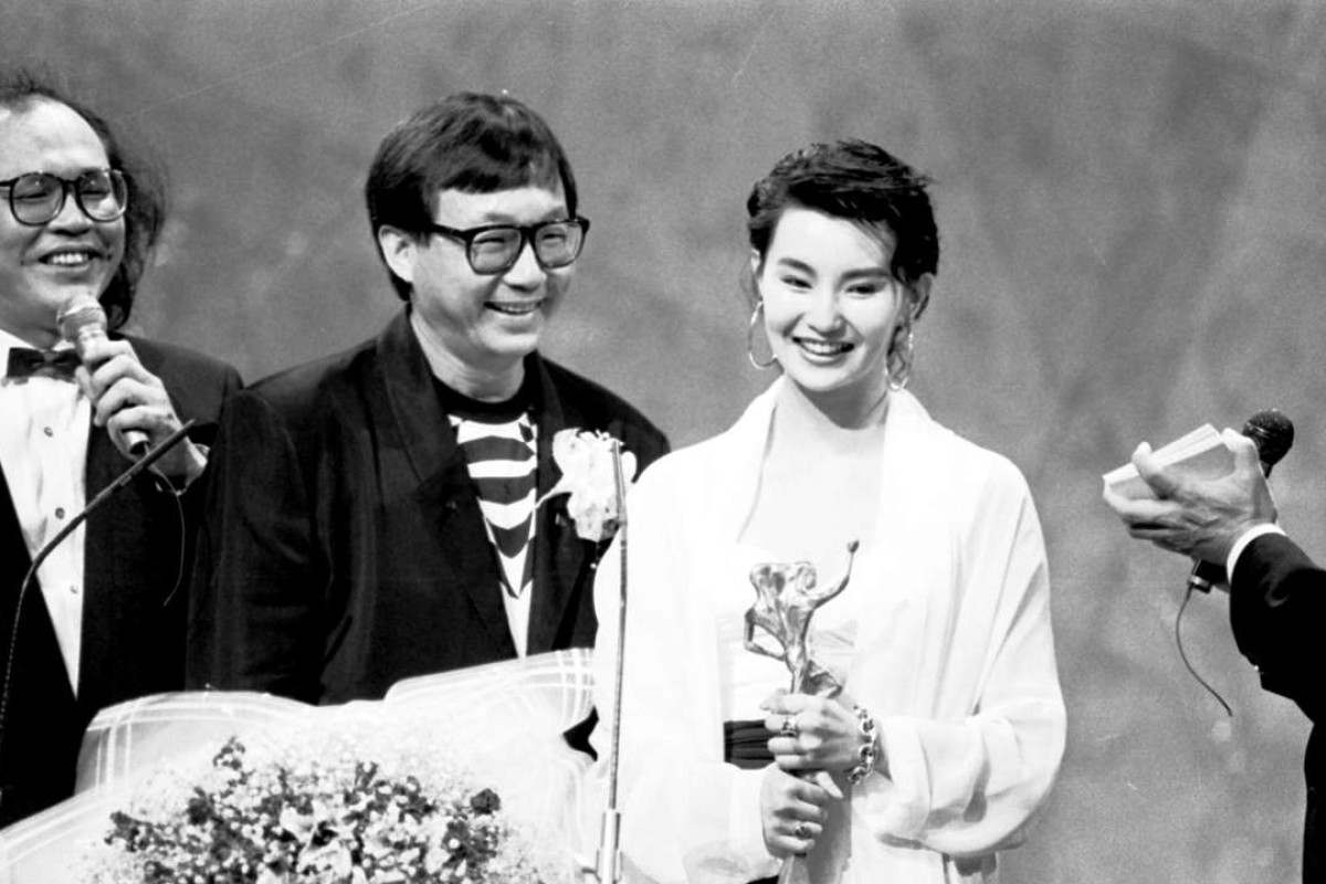 Maggie Cheung Man-yuk (third from left), the winner of the best actress award, giving an address at the Hong Kong Film Awards presentation ceremony. With her are (from left) comedians John Shum Kin-fun and Michael Hui Koon-man.