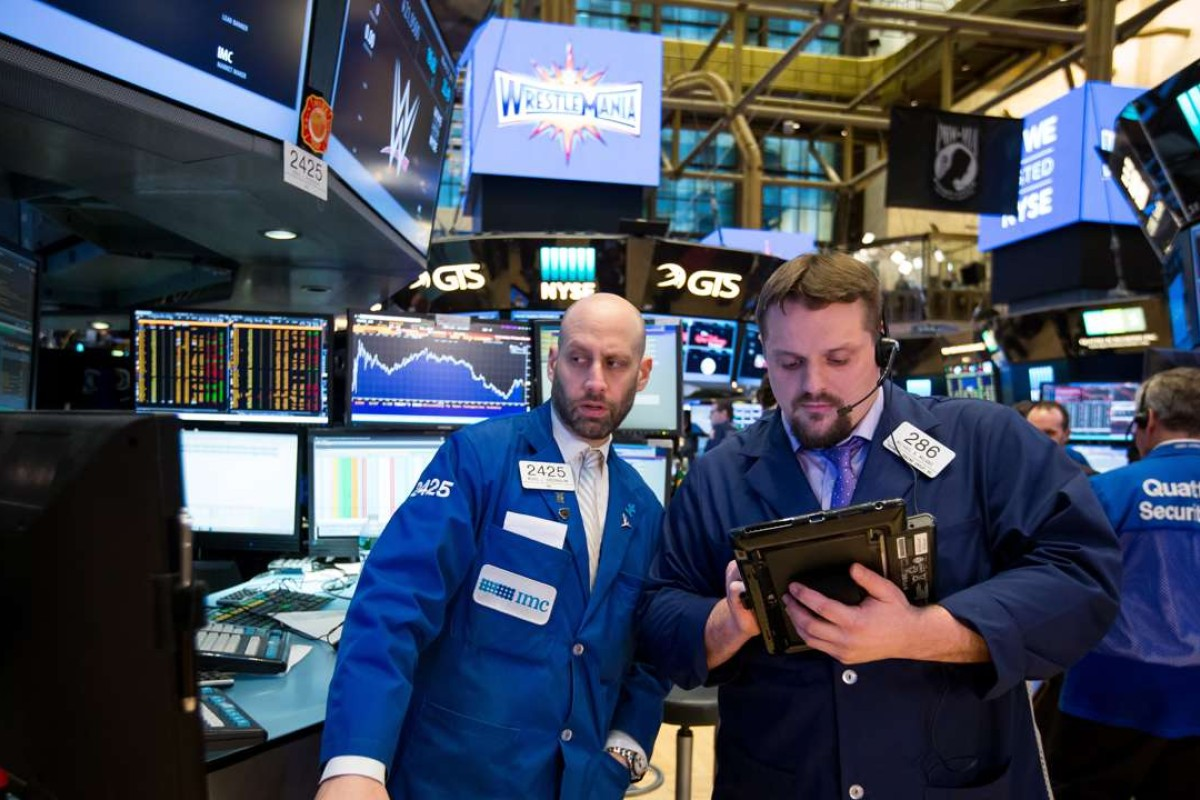 """Traders work on the floor of the New York Stock Exchange. The short-term benefits of so-called """"passive investing"""" can have dangerous implications in the long term. Photo: Bloomberg"""