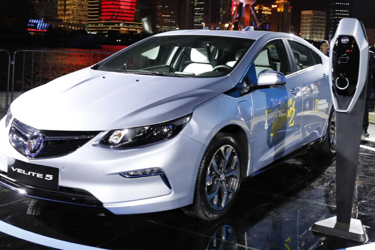 Visitors take photos of the Buick Velite 5, an extended range electric hybrid, during a global launch event ahead of the Shanghai Auto 2017 show. Photo: AP