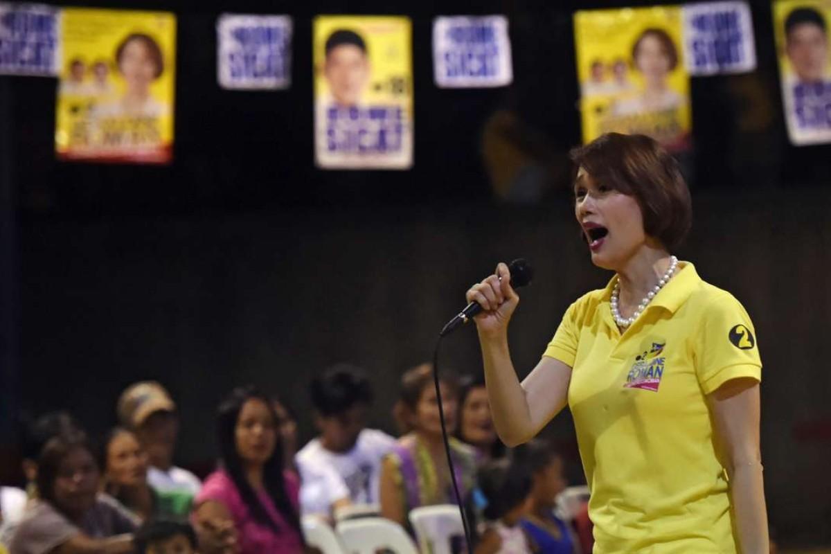 Philippine congresswoman Geraldine Roman talks to supporters in Orani, Bataan province, north of Manila. Photo: AFP