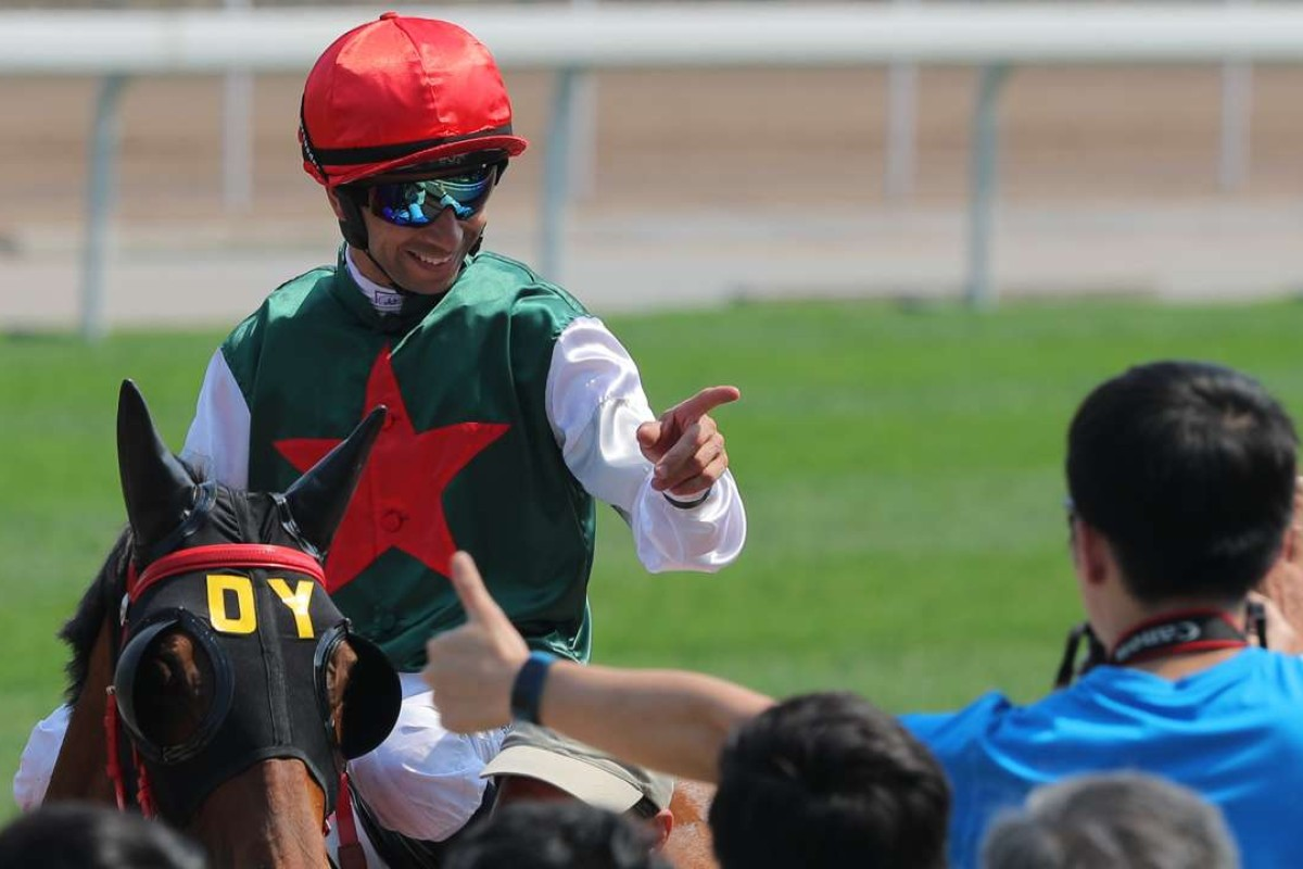 Joao Moreira celebrates his win on Metallic Star with a fan. Photos: Kenneth Chan