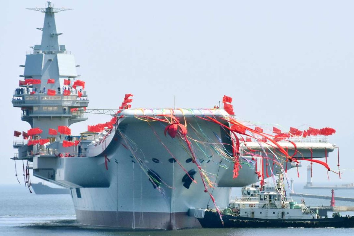 China's first domestically built aircraft carrier, the 50,000-tonne Shandong, is launched at a shipyard in the northeastern port city of Dalian. Photo: Kyodo