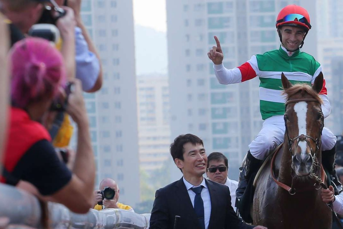 Joao Moreira salutes the crowd after his win on Neorealism in the QE II Cup. Photos: Kenneth Chan