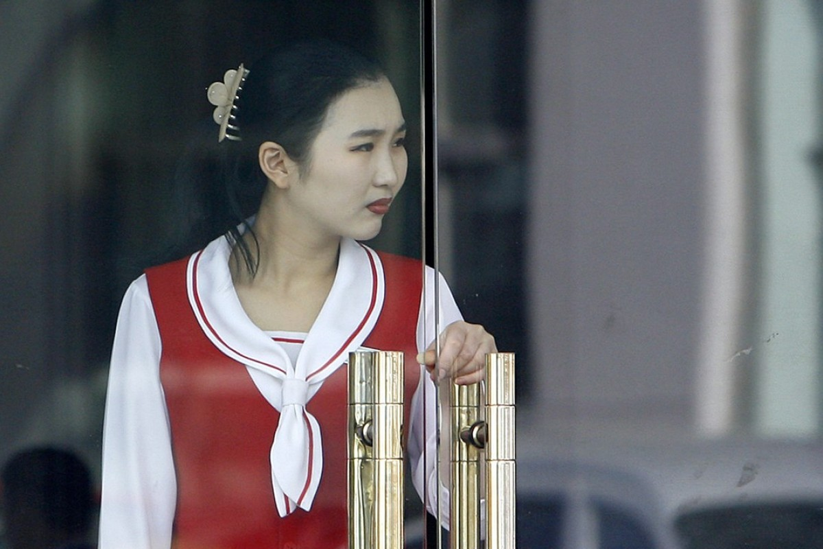 A North Korean waitress at a restaurant in Dandong, China. North Korean restaurants overseas are a vital source of foreign money for Pyongyang. Photo: AFP