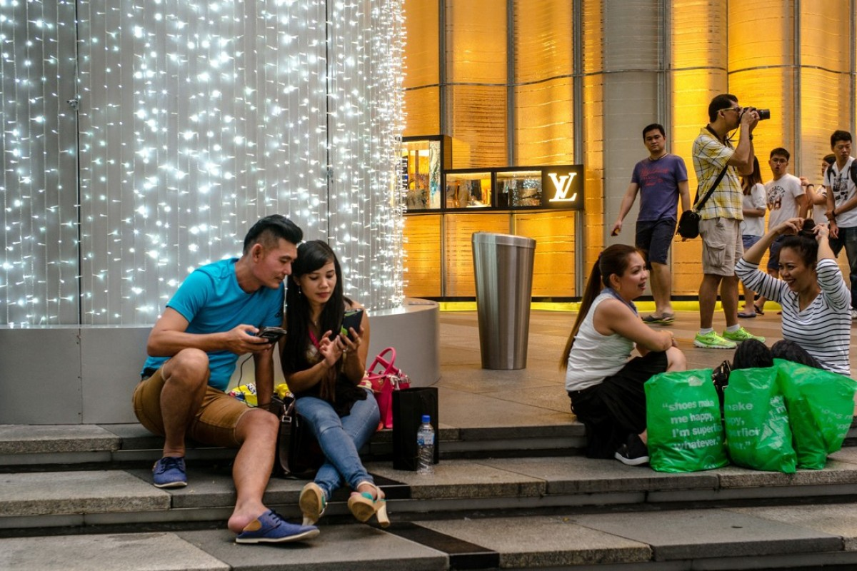 Shoppers on Orchard Road in Singapore. Some experts say the social experience of shopping will help save some brick-and-mortar stores from oblivion in an e-commerce age. Photo: Bloomberg