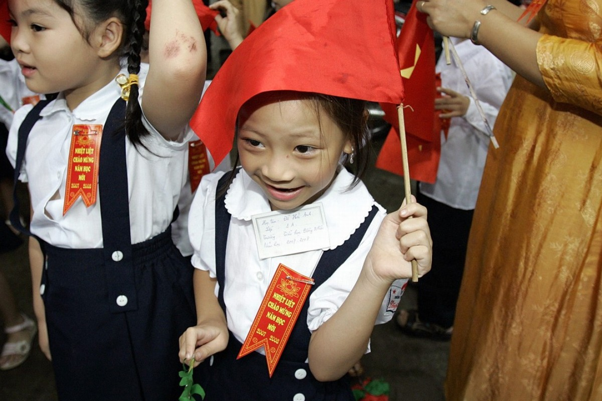 Dong Nhan Elementary students line up for an opening ceremony at the school in Hanoi, Vietnam. Photo: AP