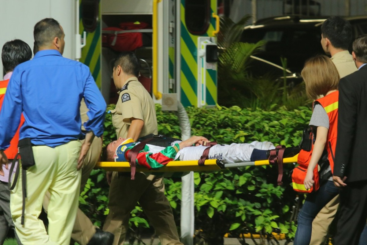 Chad Schofield is taken by stretcher to an ambulance on Wednesday night. Photos: Kenneth Chan