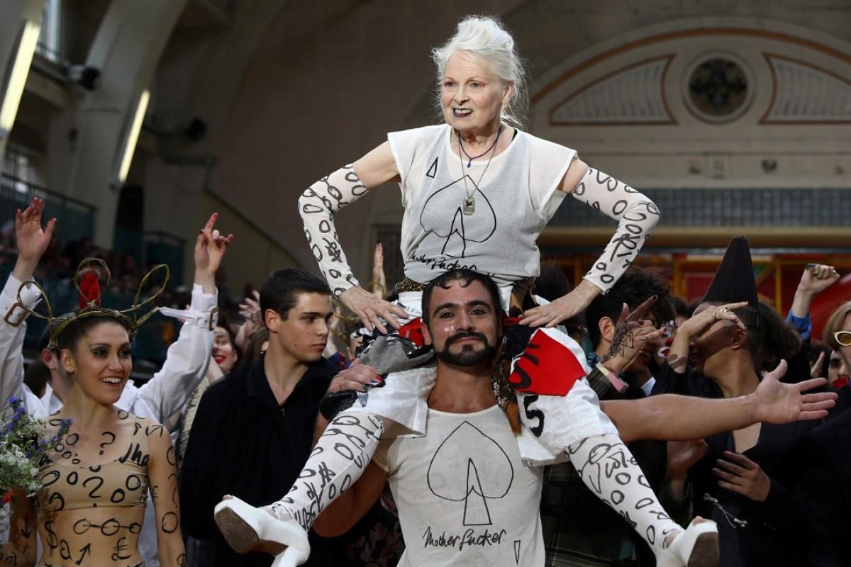 Designer Vivienne Westwood is carried after her catwalk show at London Fashion Week Men's. Photo: REUTERS