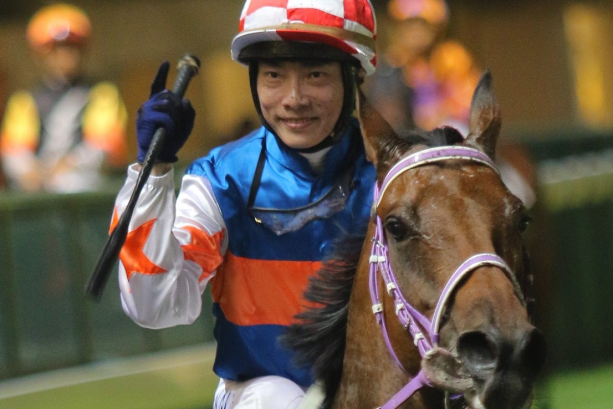 Eddy Lai is all smiles after winning aboard Racing Mate at Happy Valley on Wednesday night. Photos: Kenneth Chan