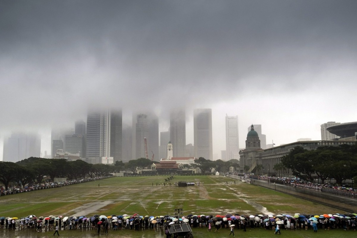 Storm clouds over Lee Kuan Yew's funeral procession. Photo: EPA