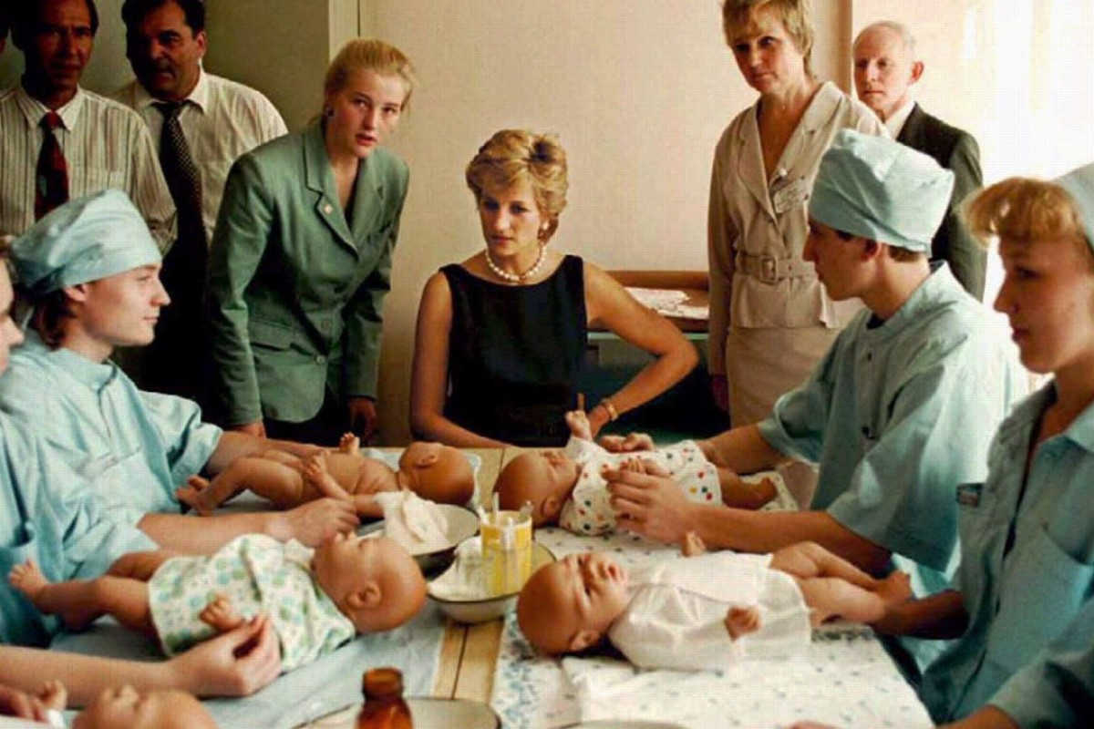 Diana talks to paediatric nurses during a visit to Tushinskaya Children's Hospital in Moscow in June 1995